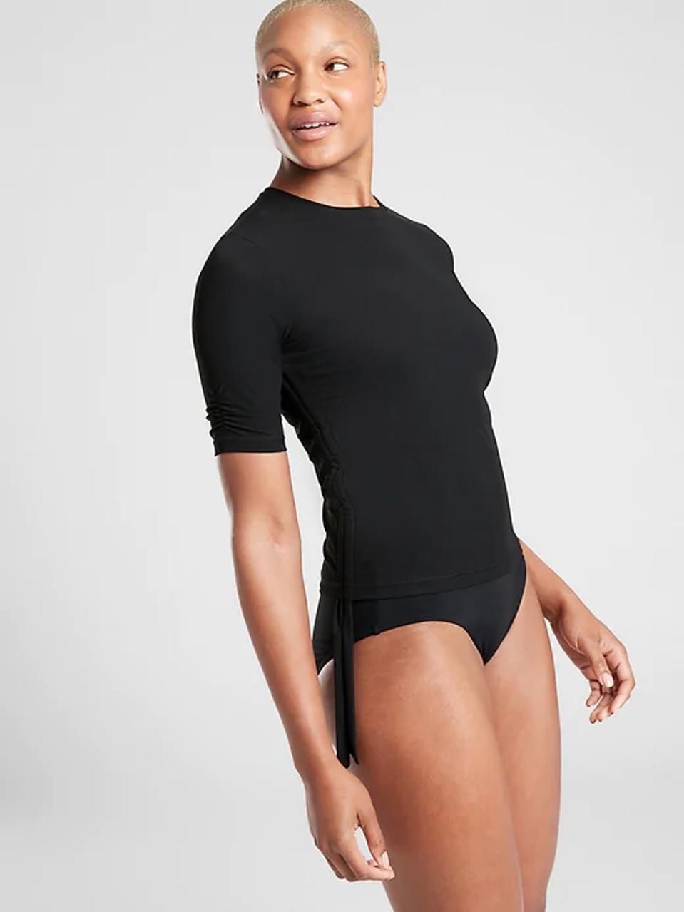 Woman wearing Athleta swimsuit