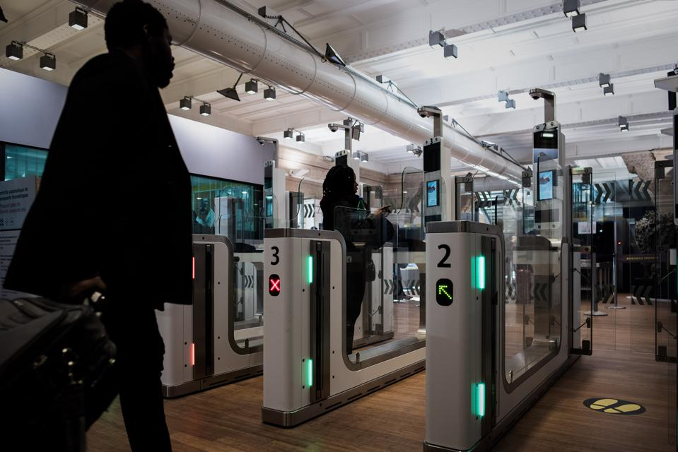 A passenger at an automated ePassport gate equipped with a facial recognition system at the gare du Nord in Paris.