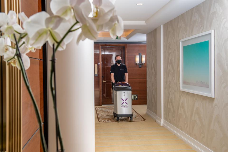 hotel employee and robot