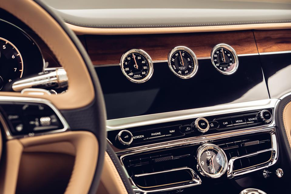 Bentley Rotating Display showing three analogue dials for outside temperature, direction, and a chronograph.