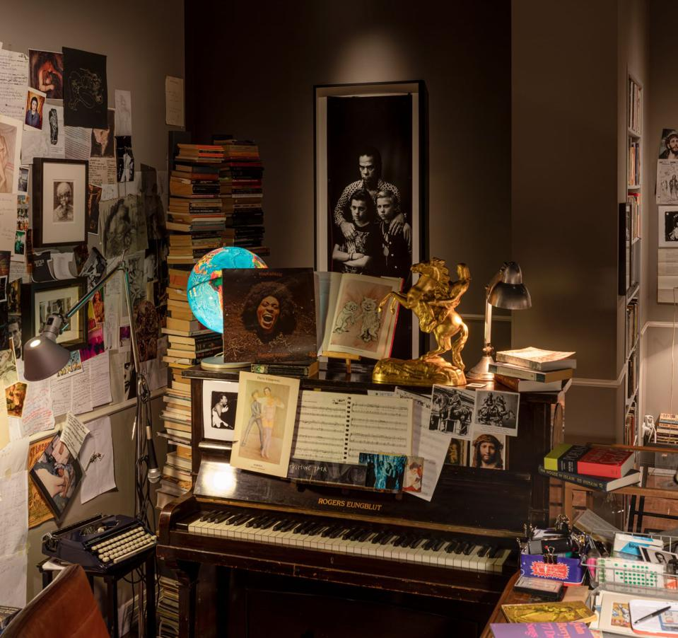 piano surrounded by albums and photos
