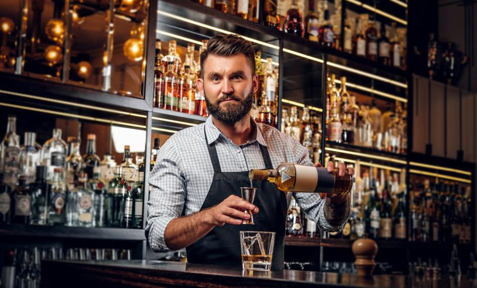 Bartender pouring a whiskey