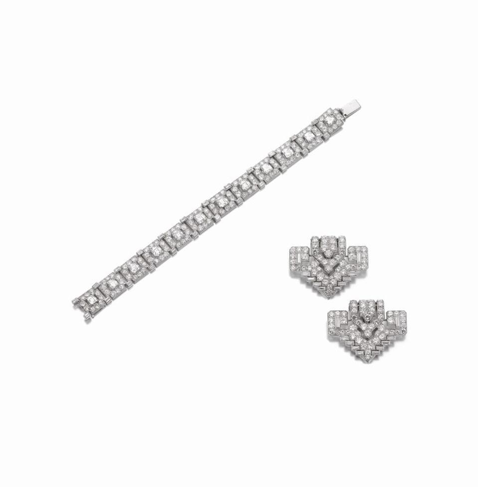 Celebrity Travel: Cartier diamond bracelet and pair of diamond clips, circa 1930