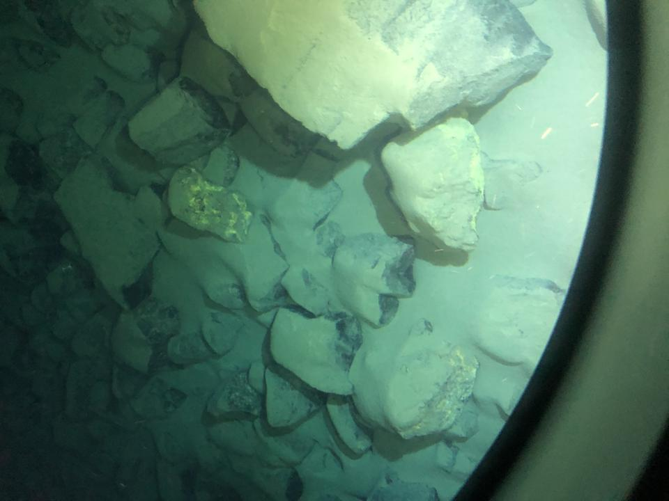 Chemosynthesis produces a gold film on rocks at the depths visited by divers in the Limiting Factor.