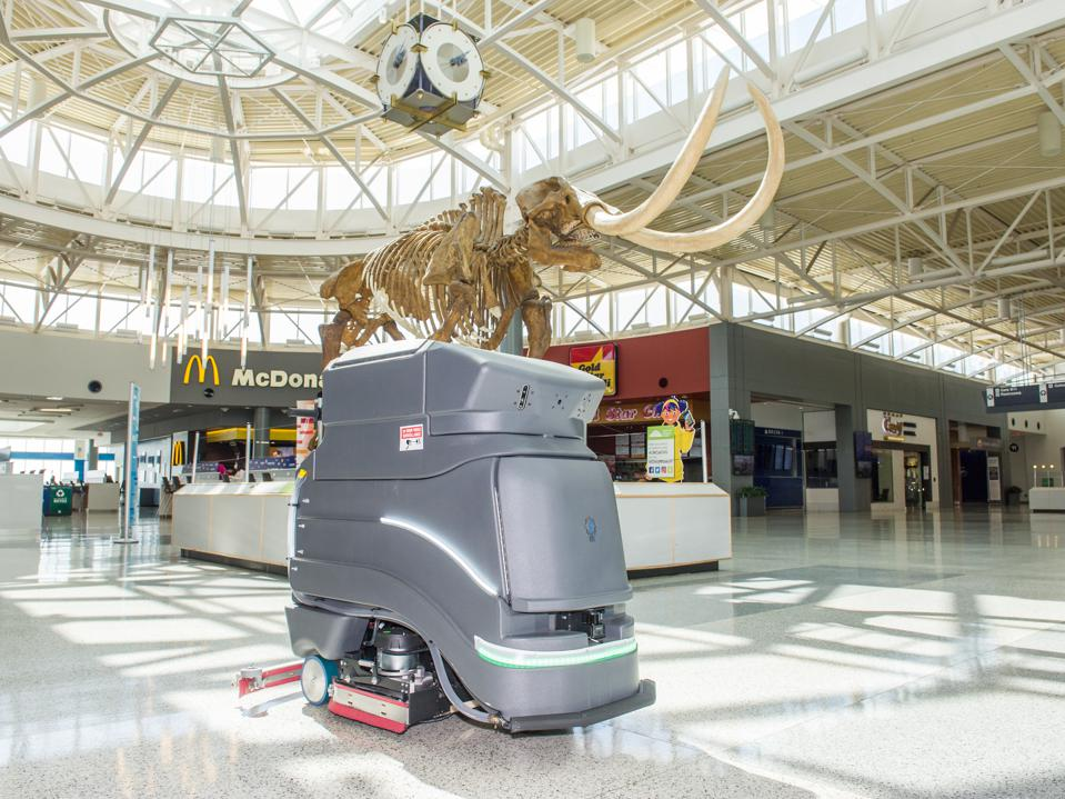 robot cleans airport