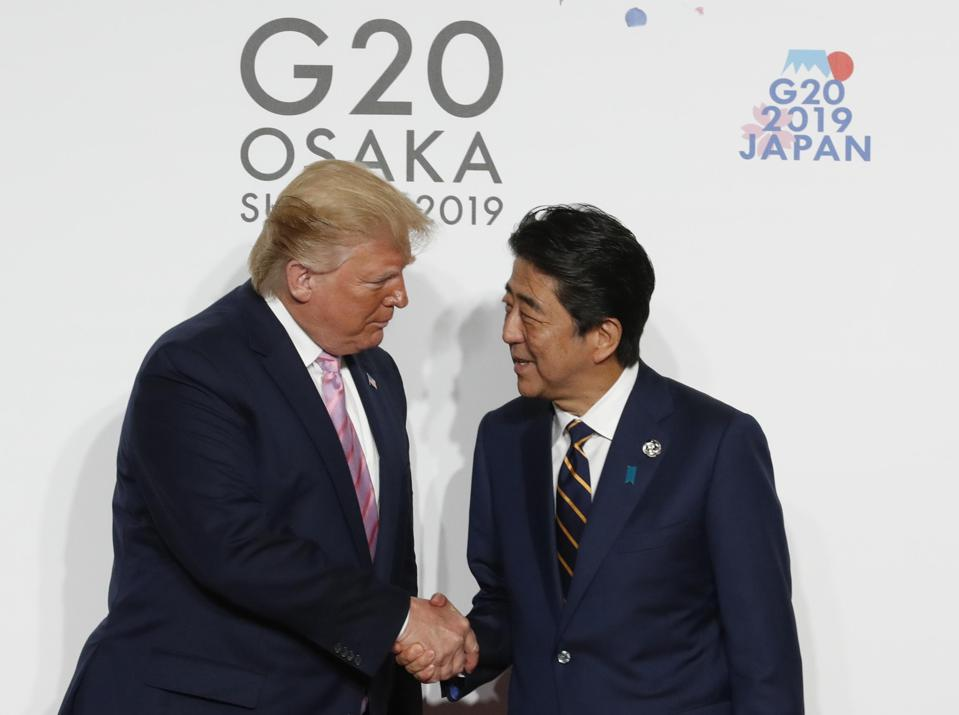 U.S. President Donald Trump welcomed by Japanese Prime Minister Shinzo Abe.