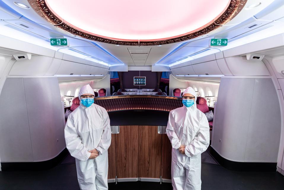 Cabin crew in PPE on Qatar Airways