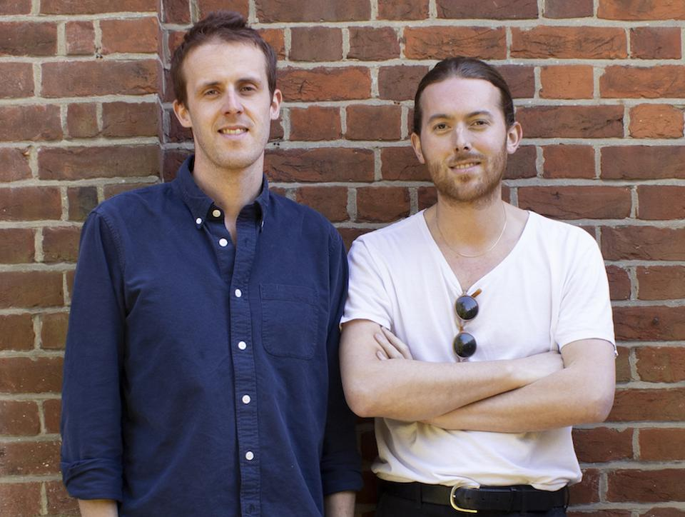 the two founders of Pep Kitchen in front of a brick wall