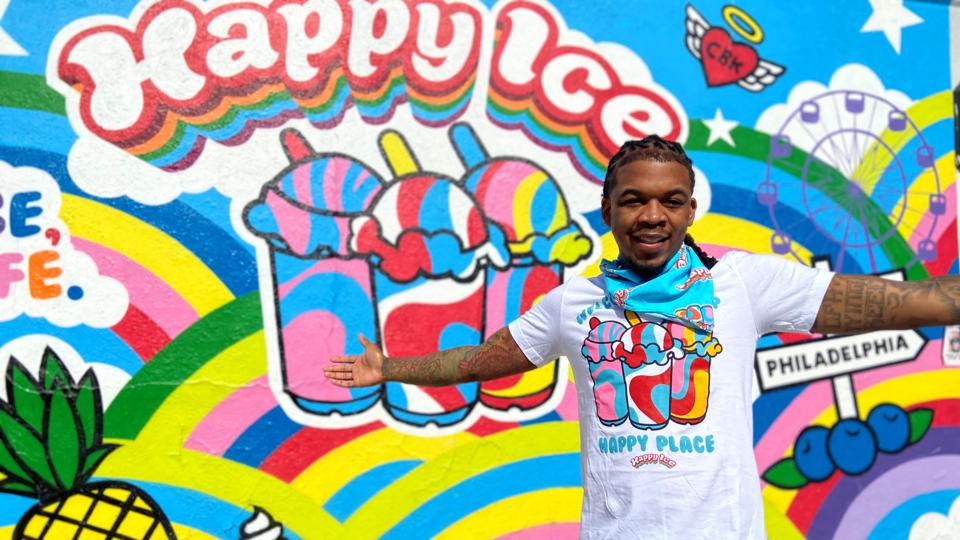 lemeir mitchell in front of a happy ice store wall