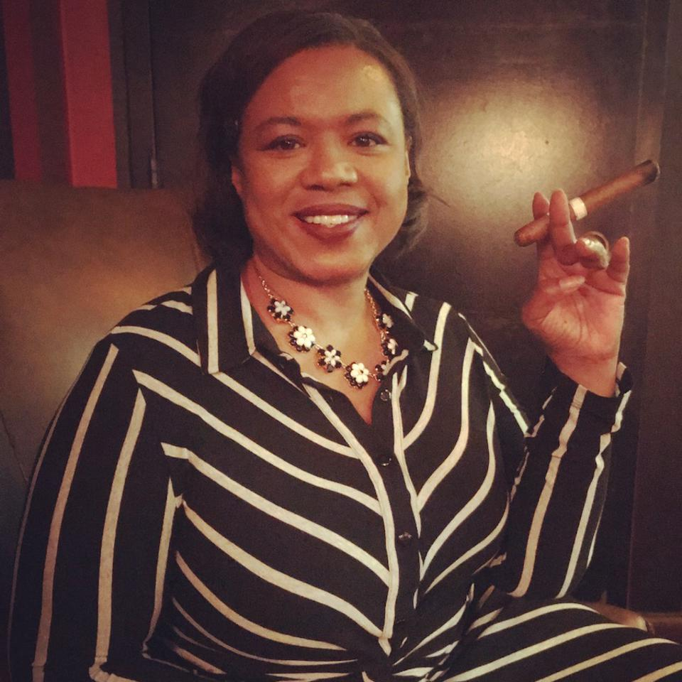 Lolita Jackson at The Carnegie Club in NYC with a cigar. Forbes, Cooking and Coping.