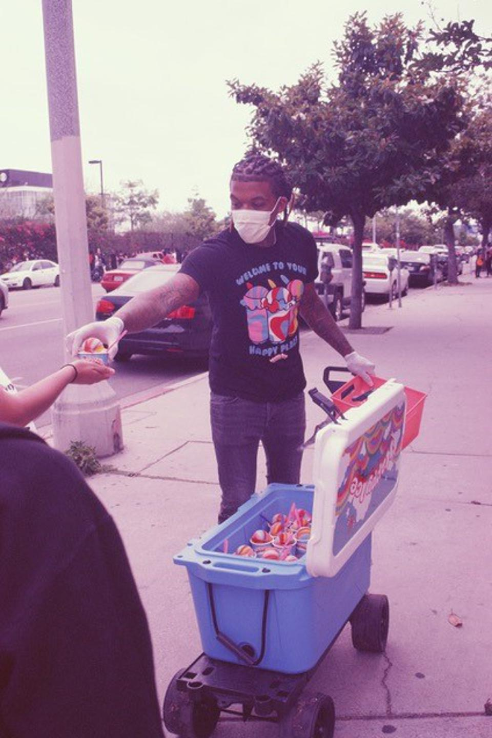Lemeir Mitchell handing out water ices from Happy Ice during the Black Lives Matter protest in Los Angeles