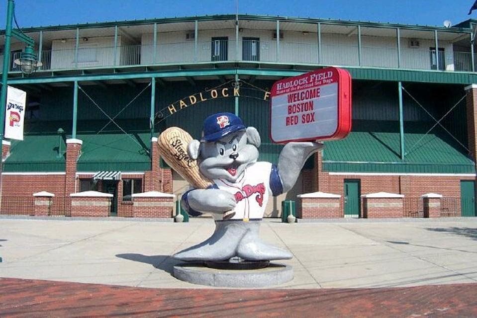 statue of Sea Dog mascot Slugger holdingan  oversized baseball bat outside of Hadlock Field in Portland Maine