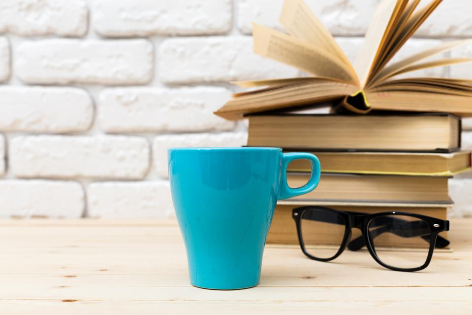 Blue Coffee Cup on Table with Glasses and Books | Top 20 Books To Read This Summer