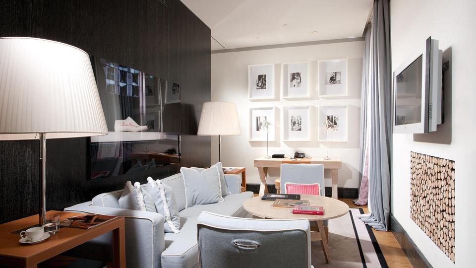 Suite at Portrait Roma hotel with soft pink, grey furnishings