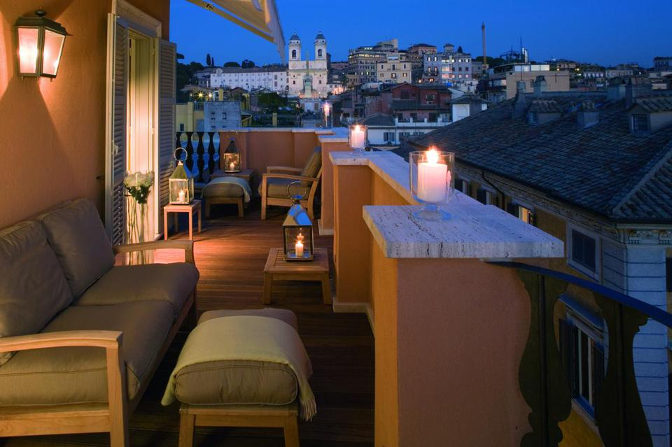 View over Rome from the Portrait Roma hotel rooftop terrace