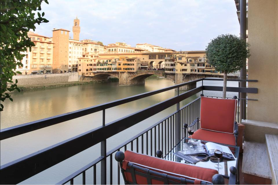 terrace of Lungarno hotel florence with ponte vecchio in backdrop