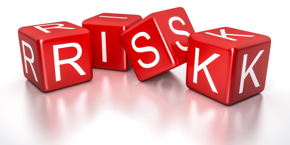 picture of red dice spelling word risk