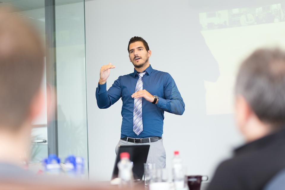 Young businessman presenting to group.