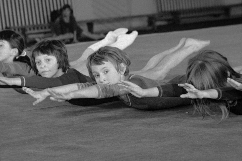 Little girl gymnasts training in ″Athlete A″