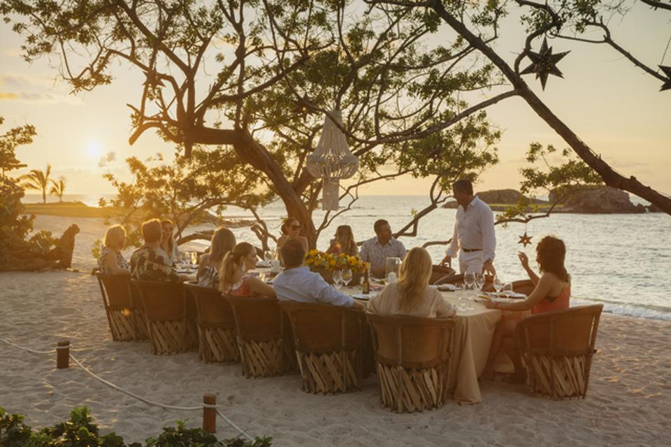 Guests enjoying beach dining