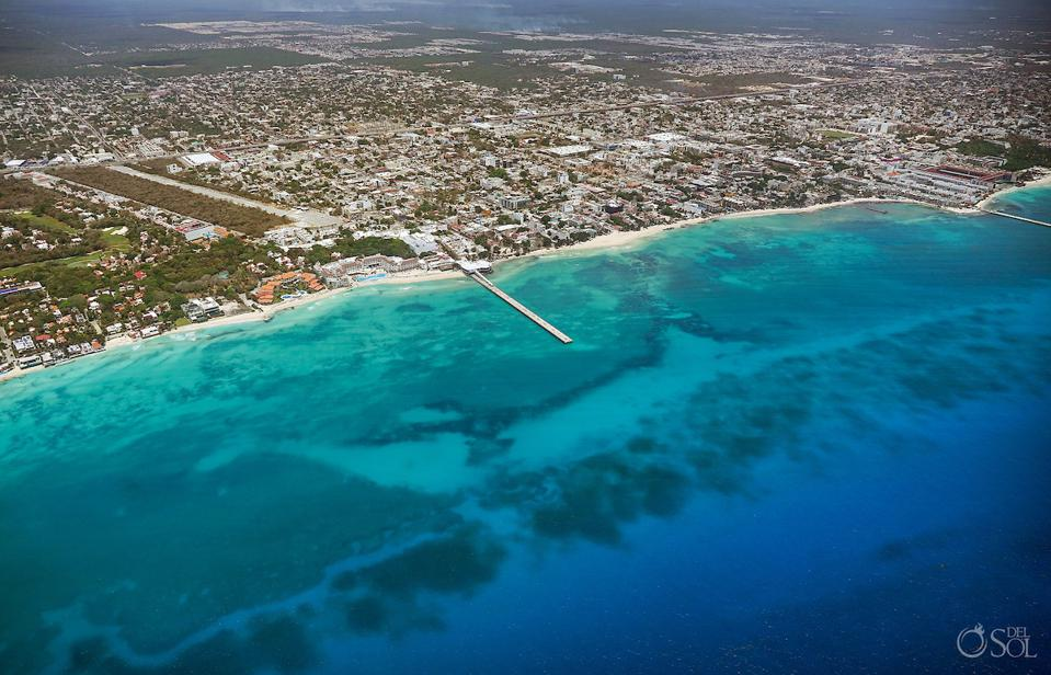 """Crystal clear waters of Playa del Carmen; the coast features the """"fall off"""" of a reef and rocks and the blue color gets darker as the depth increases"""