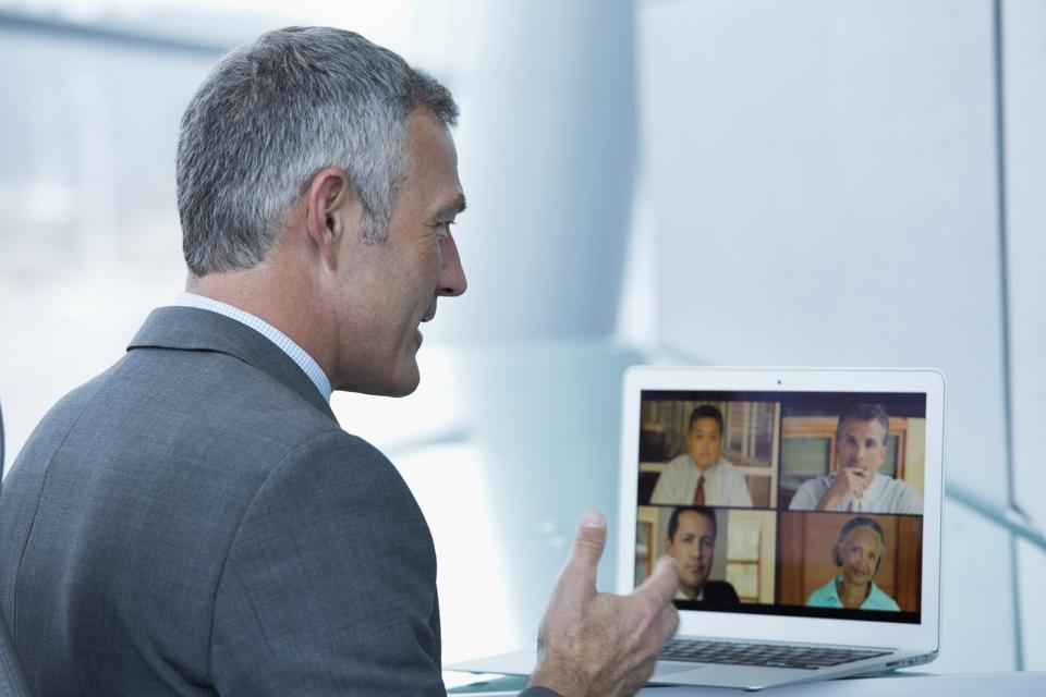 Businessman having teleconference on laptop in office
