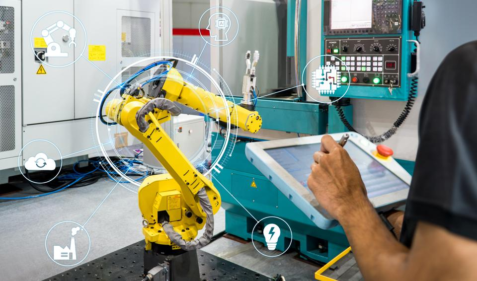 engineer check and control automation robot arms machine in intelligent factory industrial,Welding robotics and digital manufacturing operation.