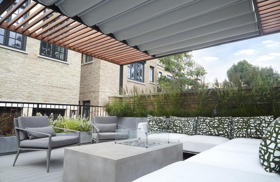 outdoor deck with roof and planters