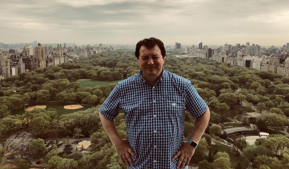 Jonathan Miller standing on the rooftops overlooking Central Park in Manhattan.