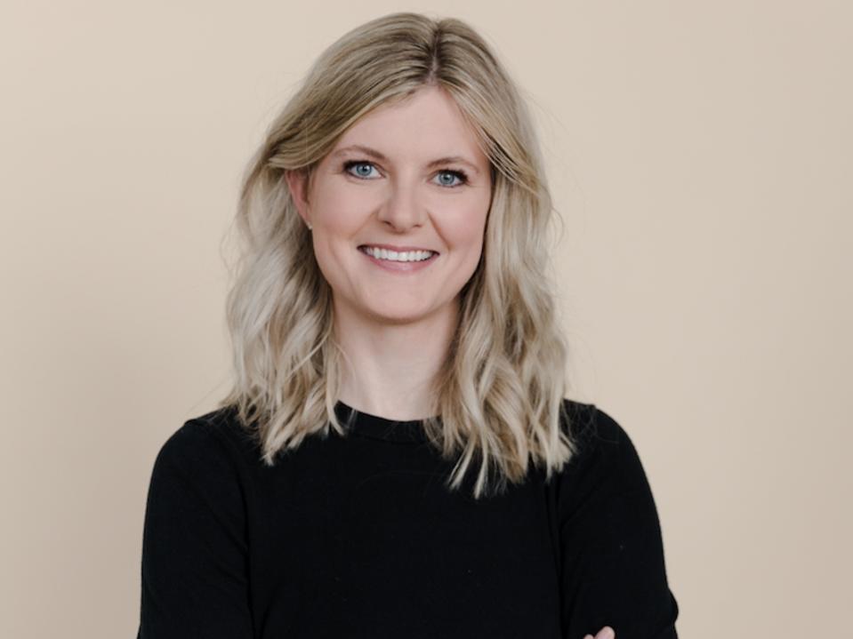 Headshot of Allison in a black top