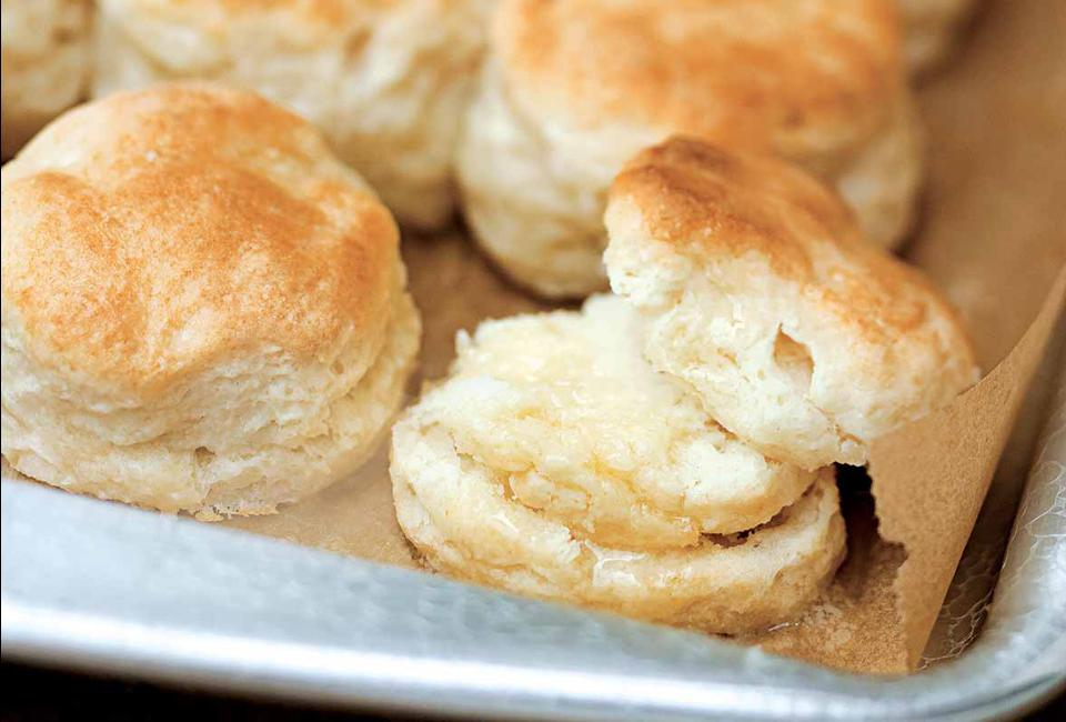 Several homemade biscuits served on a tray.