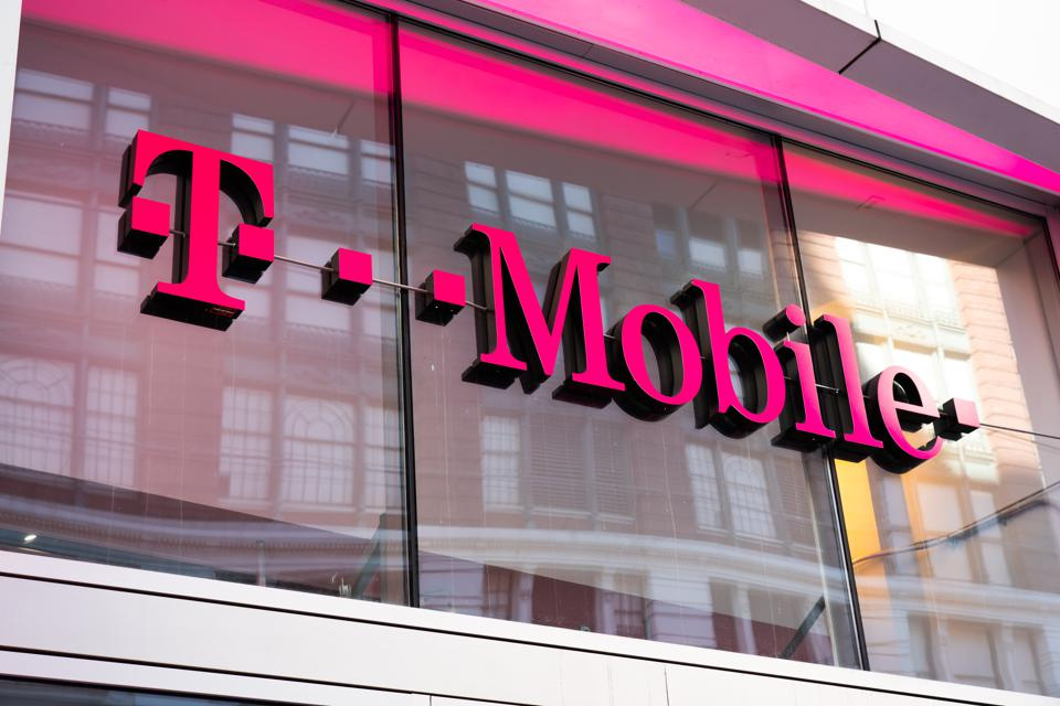 German telecommunications company, T-Mobile store logo seen...