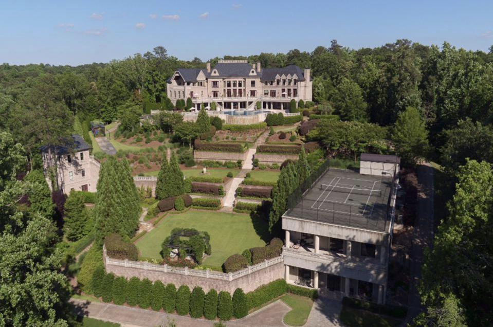 The 17 acre estate includes a 40-car motor court underneath the tennis court.