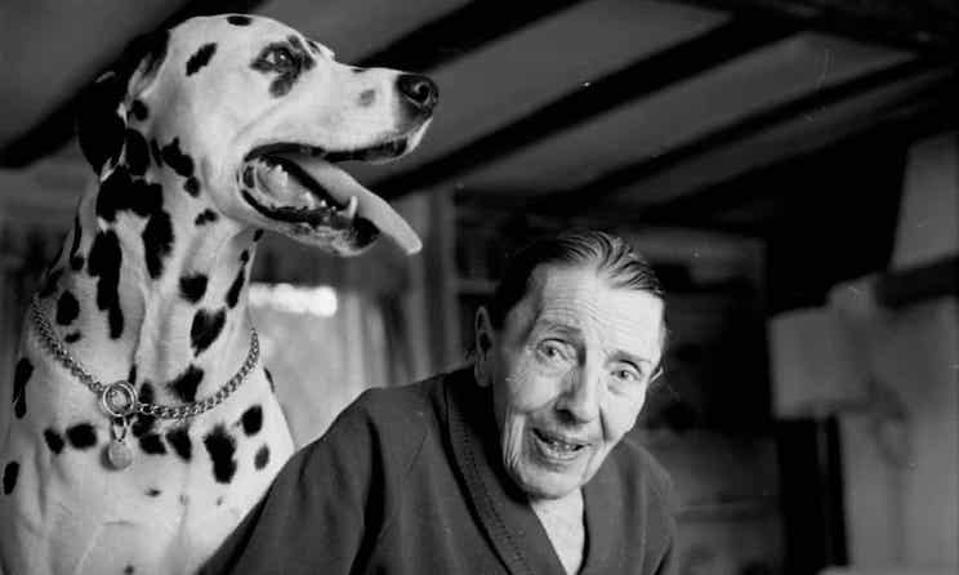 Author Dodie Smith with a Dalmatian dog