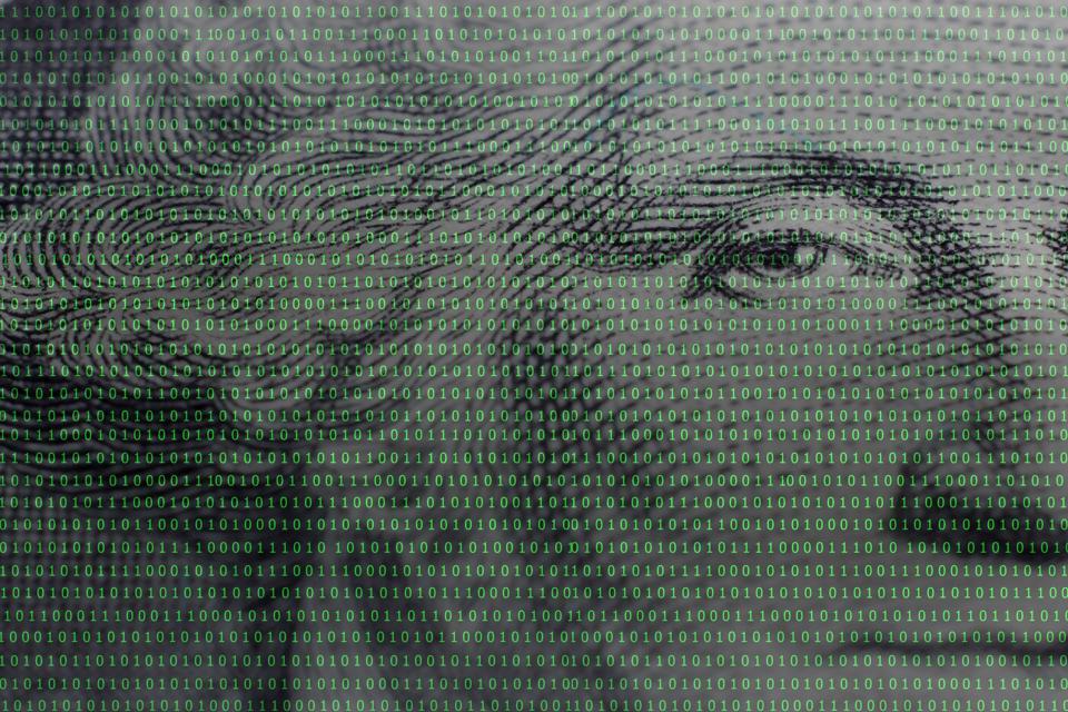 president George Washington face portrait on the USA one dollar banknote among binary code