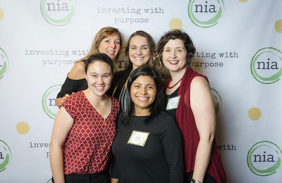 Kristin Hull, PhD (top left), CEO and CIO of Nia Impact Capital with her team.