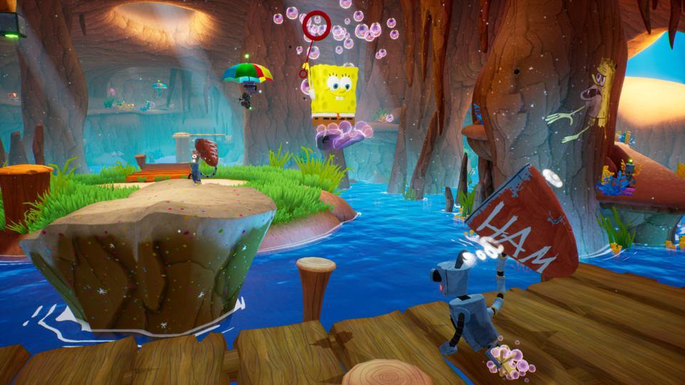 A robot attacking SpongeBob Squarepants in The Battle for Bikini Bottom Rehydrated