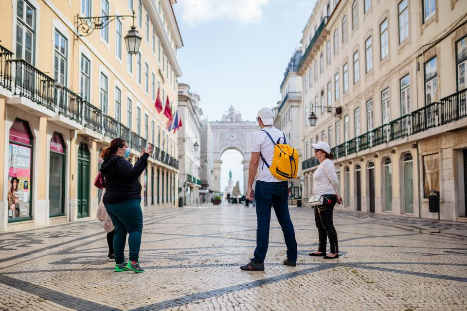Tourists social distancing on an empty Rua da Augusta in Lisbon, Portugal during the pandemic
