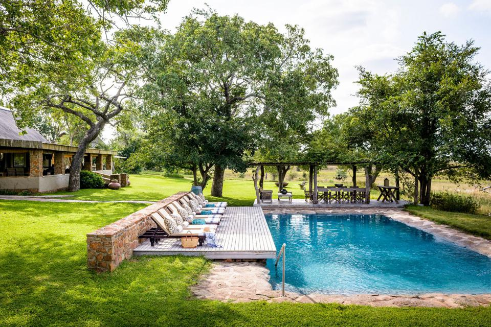 Conservation Africa News - The swimming pool and main house at South Africa's Singita Castleton private villa.