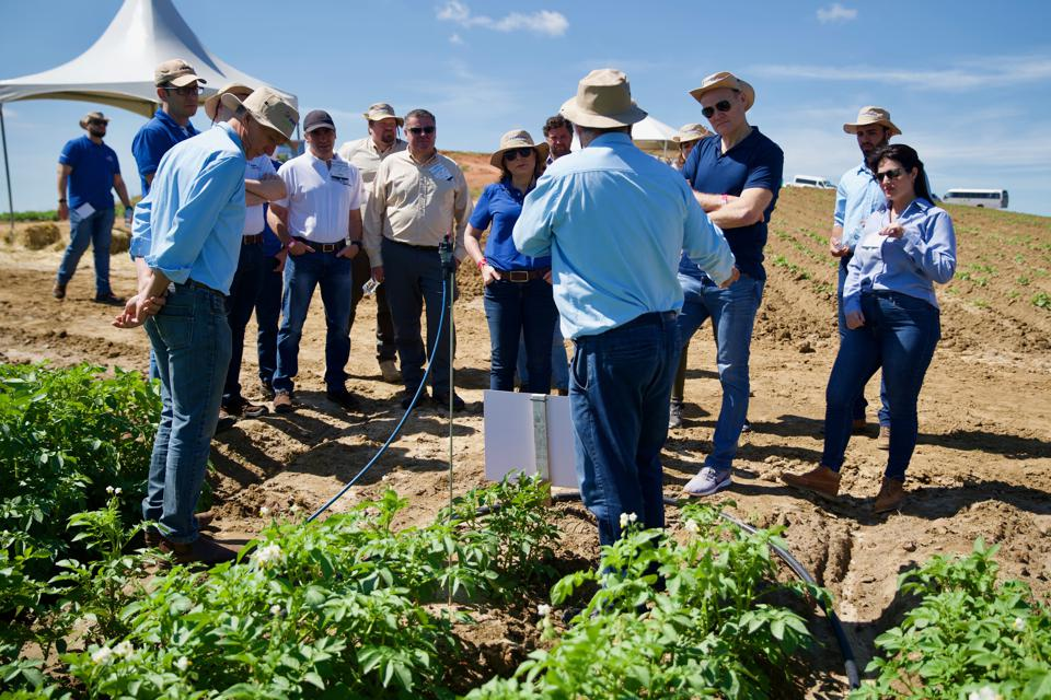 PepsiCo Chief Sustainability Officer Simon Lowden visiting a demonstration farm in Brazil.