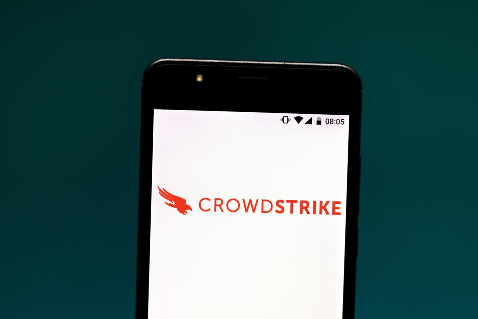 In this photo illustration the CrowdStrike logo is seen...