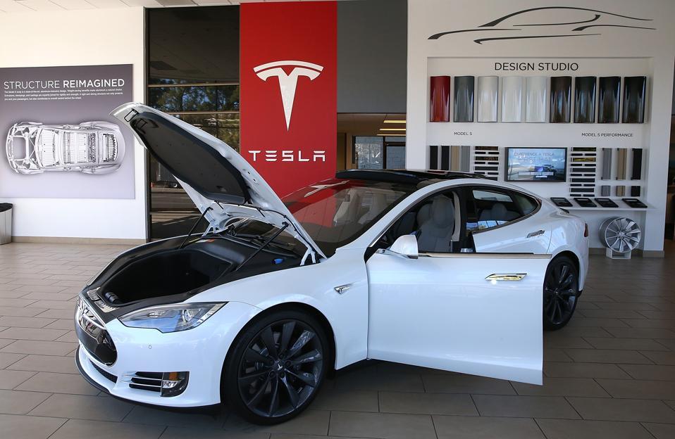 Electronic Car Maker Telsa Reports Quarterly Earnings