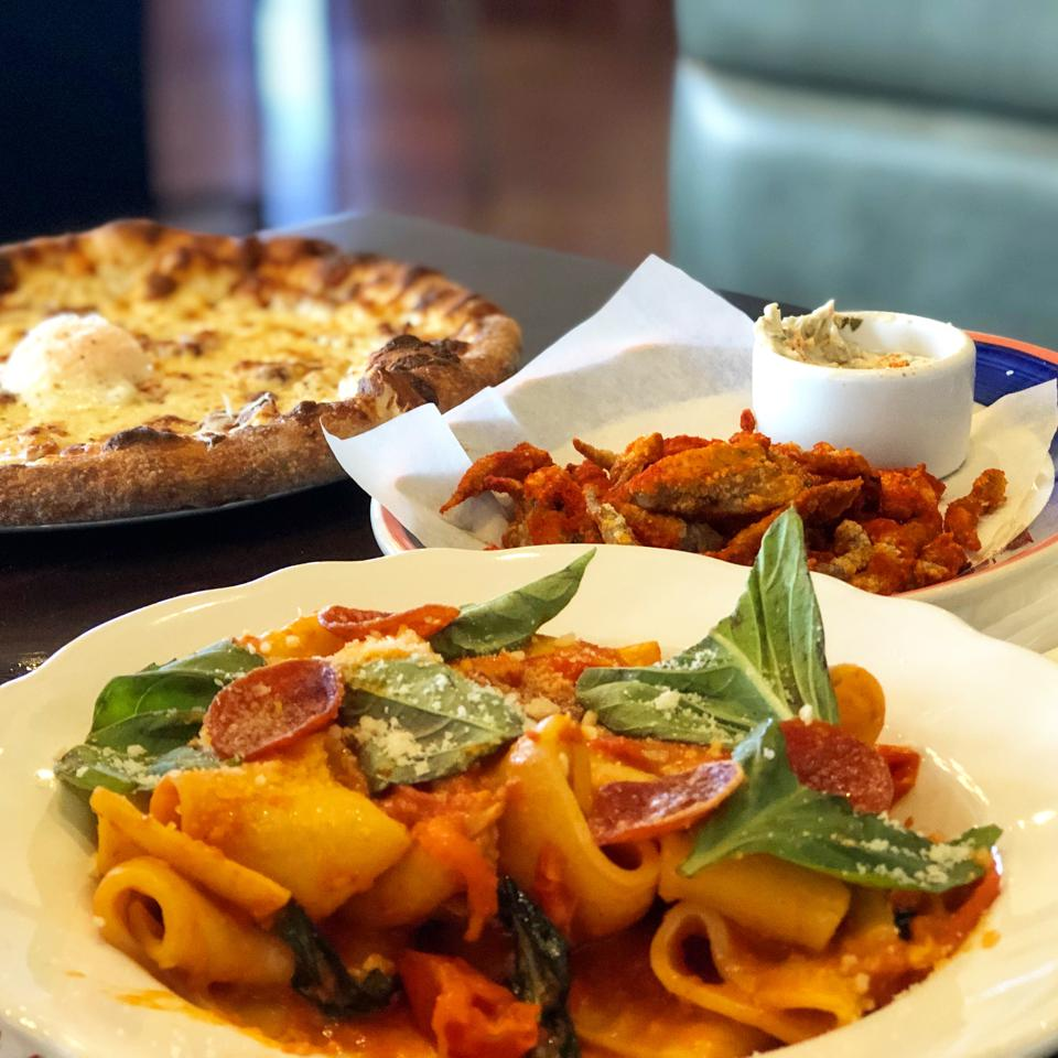 Paccheri Arrabbiata with spicy Ezzo pepperoni; Fried Smelts with sweet chili and tartar sauce; and Carbonara Pizza with smoked pancetta and poached egg at Mad Bene on Oahu.