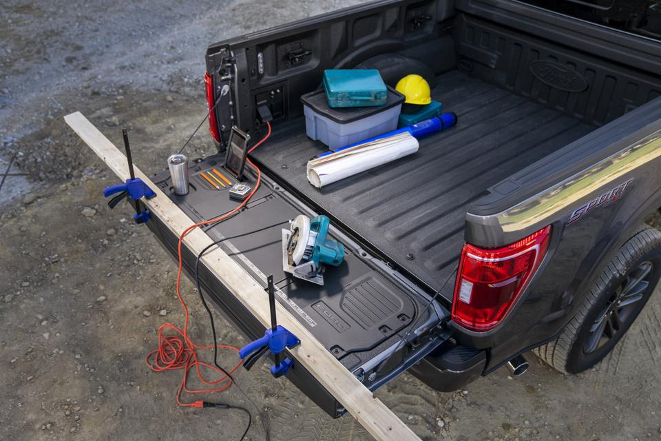 2021 Ford F-150 work surface tailgate has slots for tablets, pencils and drinks, a built-in ruler, slots for clamps and cleats for tie-downs on the ends