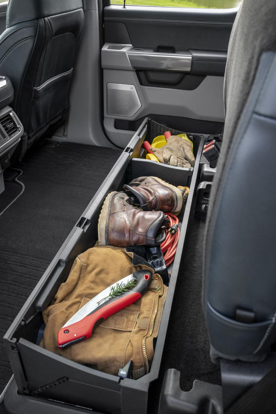 2021 Ford F-150 pop up rear seat storage. Rear seat can be locked when folded down