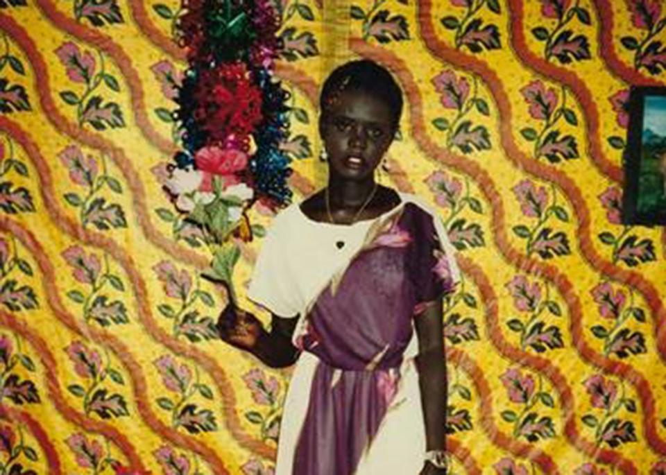 In 1999, Rebecca Deng was 14 and living in Kenya's Kakuma refugee camp. This photo was taken a day after an ″engagement party″ known as Kaany. She narrowly escaped being married off to a much older man.