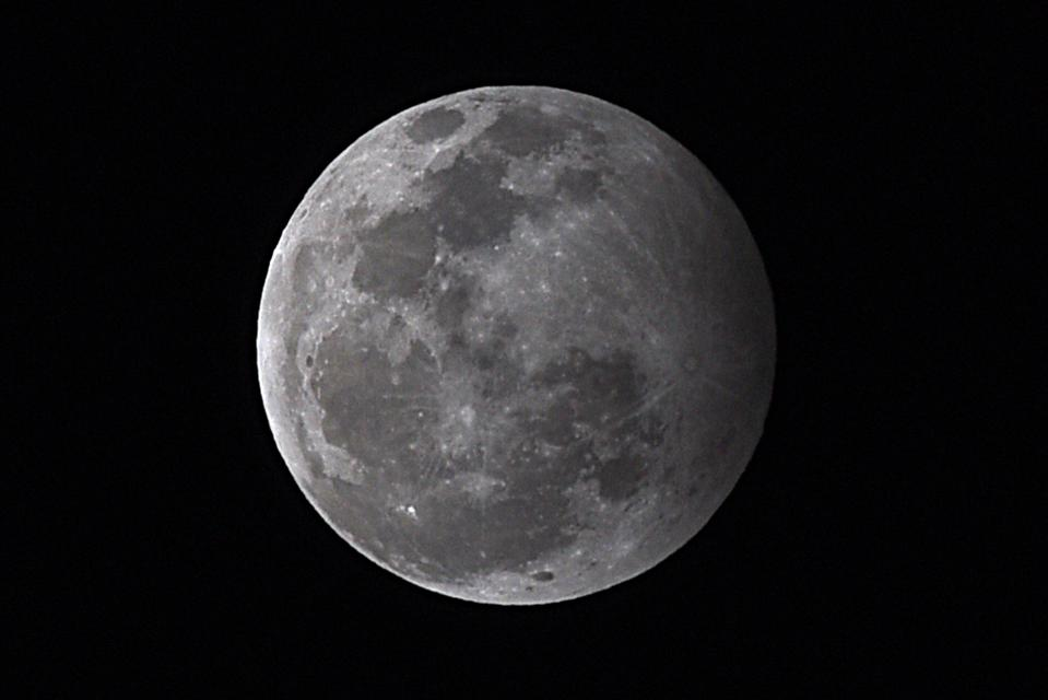 A ″penumbral″ lunar eclipse sees the full Moon significantly dull.