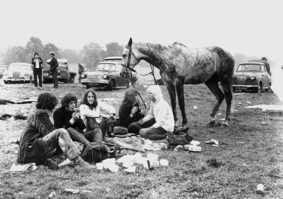 Festival goers and horse at Glastonbury