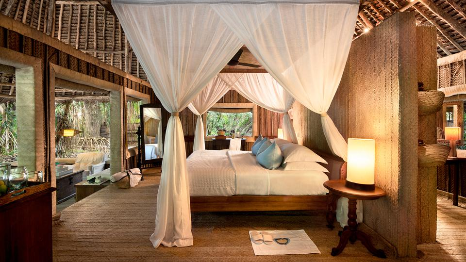 The opulent bed at andBeyond Mnemba Island.