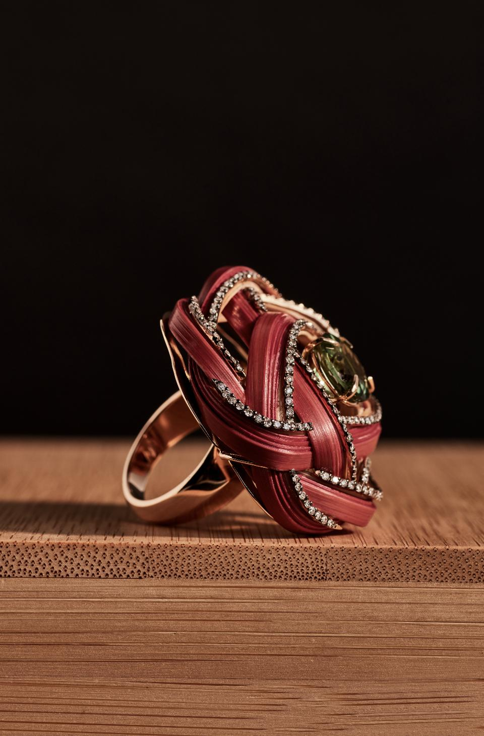 This ring shows the delicate craftsmanship and mix of bamboo and precious gems